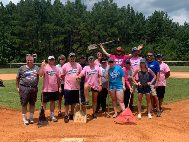 Members of the Blue Wahoos front office staff joined together to help restore a youth league baseball field at Bradberry Park in Walnut Hill.