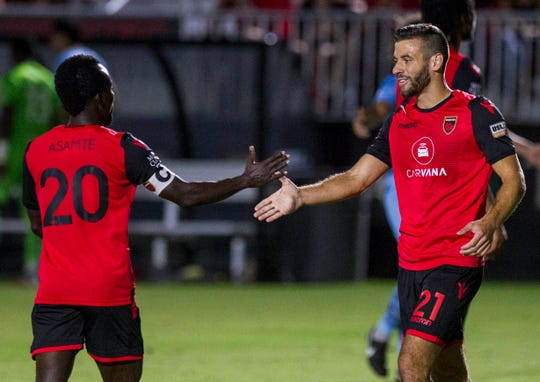 Phoenix Rising's Solomon Asante gets congratulations from  Joey Calistri during their game against El Paso at Casino Arizona Field in Tempe Aug 10, 2019. (Darryl Webb/For the Republic)