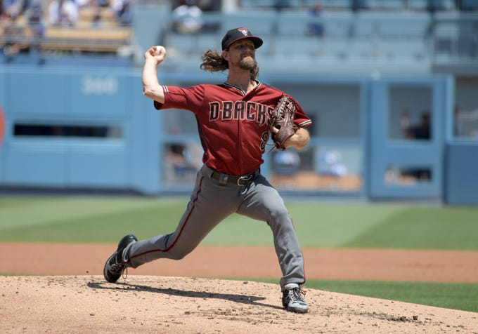 Aug 11, 2019; Los Angeles, CA, USA; Arizona Diamondbacks starting pitcher Mike Leake (8) delivers a pitch in the second inning against the Los Angeles Dodgers at Dodger Stadium. Mandatory Credit: Kirby Lee-USA TODAY Sports