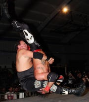 "Pro wrestler Jerry ""The King"" Lawler piledrives actor David Arquette at a Northeast Wrestling card in Danbury, Connecticut on April 28."