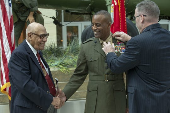 Melvin G. Carter thanks Master Gunnery Sgt. Carroll W. Braxton (Ret.), left, for pinning the rank of brigadier general to his collar during a ceremony in which he was promoted to brigadier general in the United States Marine Corps at the National Museum of the Marine Corps in Triangle, Virginia, August 9, 2019.
