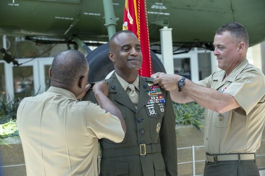 Melvin G. Carter gets pinned to the rank of brigadier general by Brig. Gen. Dimitri Henry and Maj. Gen. Michael Groen during a ceremony in which he was promoted to brigadier general in the United States Marine Corps at the National Museum of the Marine Corps in Triangle, Virginia, August 9, 2019. 
