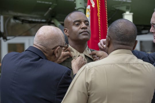 Master Gunnery Sgt. Carroll Braxton (Ret.) pins the rank of brigadier general on Melvin G. Carter during a ceremony in which he was promoted to brigadier general in the United States Marine Corps at the National Museum of the Marine Corps in Triangle, Virginia, August 9, 2019. Carter grew up in York, Pennsylvania and enlisted in the Marine Corps in 1985.
