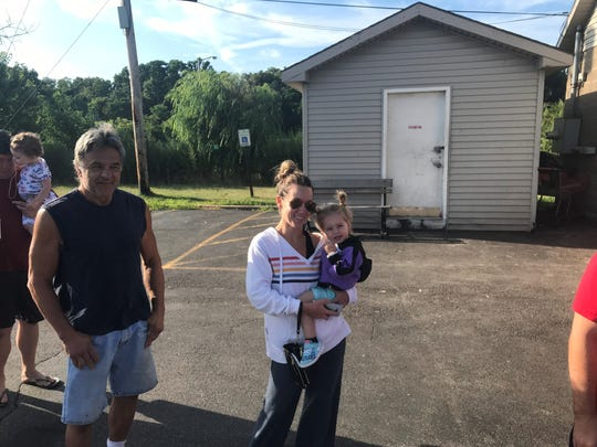 Jimmy Cimino and Erin Smith with her daughter waiting for Italian cookie doughnuts at Ridge Donut.