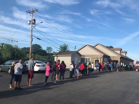 Line of about 100 customers outside Ridge Donut Sunday morning.