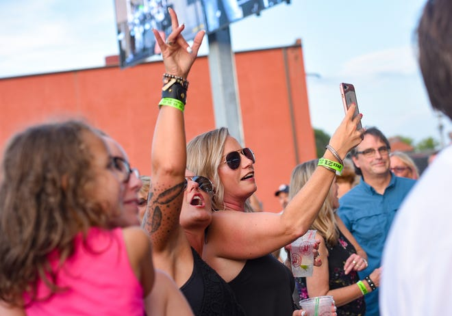 Rachel Wentzel and Kara Andela sing along to Kory and the Fireflies as they perform the final concert of the season at Levitt at the Falls on Saturday evening, August 10, in Sioux Falls. Wentzel said they have been long-time followers of the band.