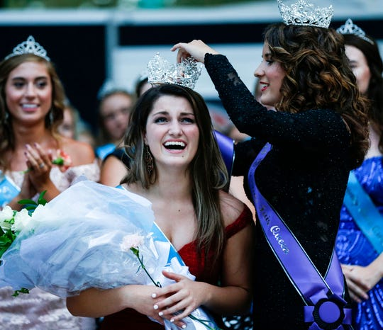 Hailey Swan, the 2018 Iowa State Fair Queen, pins a crown on Hannah Koellner, of Mahaska County, after she was named the 2019 Iowa State Fair Queen on Saturday, August 10, 2019, during the annual queen coronation ceremony.