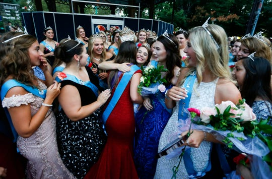 Hannah Koellner, of Mahaska County, is embraced by other county fair queens after she was named the 2019 Iowa State Fair Queen on Saturday, August 10, 2019, during the annual queen coronation ceremony.