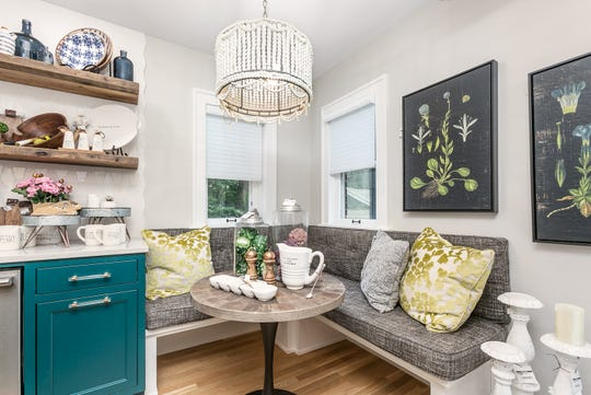 Haden and Brady created a considerable amount of kitchen space by removing a door that connected the kitchen to the attached greenhouse. It gave them the space needed to create this built-in breakfast nook.
