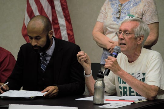 Don Fitz, right, a member of the Green Party of St. Louis, comments on the Green New Deal at a panel discussion at the Library Center on Saturday, August 10, 2019.