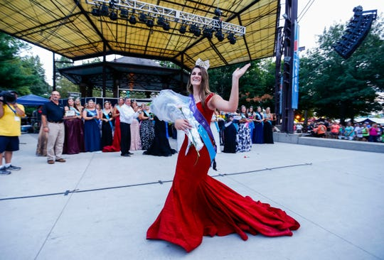 Hannah Koellner, of Mahaska County, waves to the crowd after being named the 2019 Iowa State Fair Queen on Saturday, August 10, 2019, during the annual queen coronation ceremony.