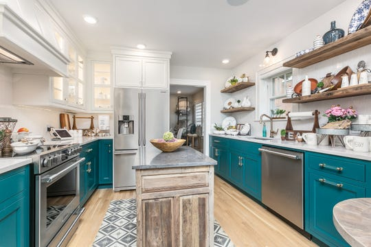 The bright, stylish kitchen shows just how much is possible with a galley kitchen.