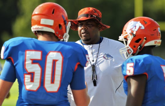 New Taylor County coach Maurice Belser talks to his team as Chiles beat Taylor County 28-0 during a one-half scrimmage, part of a referee clinic, on Aug. 10, 2019 at Chiles