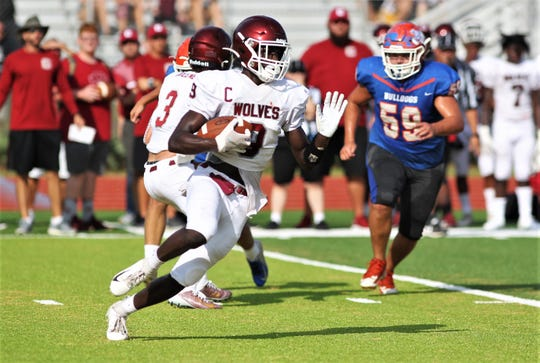 Chiles running back Jalen Herring runs for a gain as Chiles beat Taylor County 28-0 during a one-half scrimmage, part of a referee clinic, on Aug. 10, 2019 at Chiles