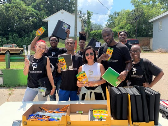 Goldie Sound Productions staff celebrate its first Back 2 School Drive on Saturday, Aug. 10, 2019. From left to right: (back) Zarbarous Brown, Brandon Moore and Shawn Brancheelor. (Front) K'eyla Coulombe, Blu Chapman, Kim Dickey, Adrian Dickey and Lequita Sharrock.
