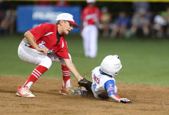Haverstraw shortstop Nick Becker (22) puts a tag on Elmora's Yamil Soto (4) during the Mid-Atlantic regional little league final at the Giamatti Little League Center in Bristol, Conn. on Saturday, August 10, 2019.