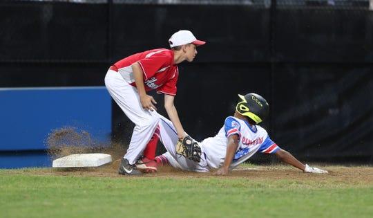 Haverstraw third baseman Joseph Savignano (11) attempts a tag on Elmora's Emmanuel Nunez (3) during the Mid-Atlantic regional little league final at the Giamatti Little League Center in Bristol, Conn. on Saturday, August 10, 2019.