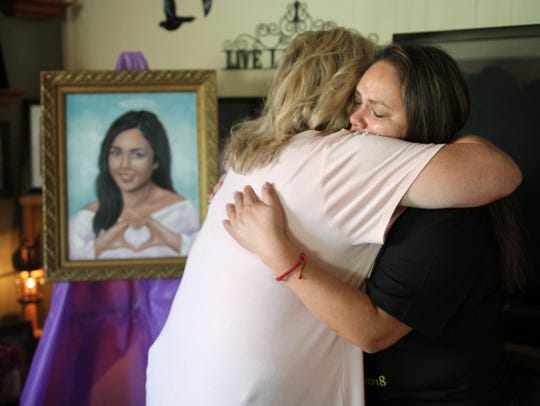 Mayela Garcia gets support as she cries after the unveiling of her daughter's Yajaira's portrait who was murdered last year on Nov. 3. This file photo is from Aug. 10, 2019, at the home of Bianka and Vern Landavazo, whose daughter Lauren was murdered on Sept. 2, 2016.