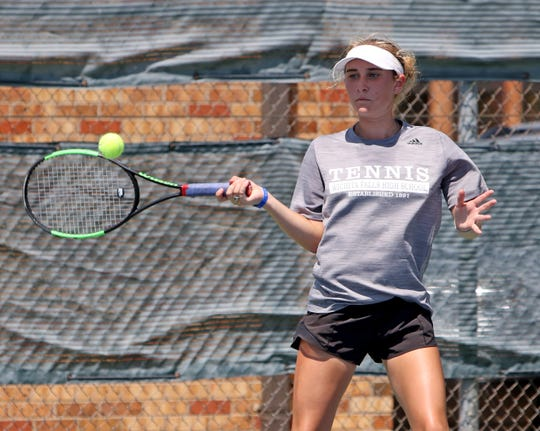 Wichita Falls High School's Hattie Berend hits a return in a doubles match against Vernon in a tournament Saturday, Aug. 10, 2019, at Midwestern State University.
