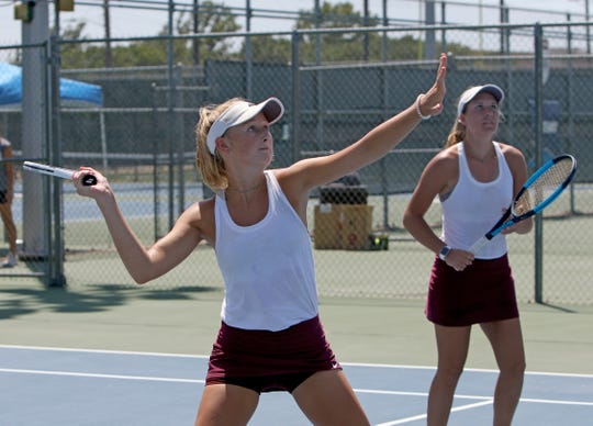 Vernon's Sarah Castleberry and Caroline Taylor compete in a doubles match against Wichita Falls High School in a tournament Saturday, Aug. 10, 2019, at Midwestern State University.