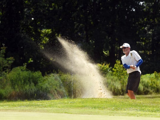 Bob Plants blasts out of the greenside bunker on the 17th hole during the 2019 Zanesville District Golf Association Senior Amateur at Vista Golf Course. Plants holed the shot for a birdie.