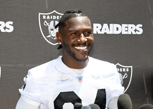 Oakland Raiders receiver Antonio Brown (84) reacts during organized team activities at the Raiders practice facility.