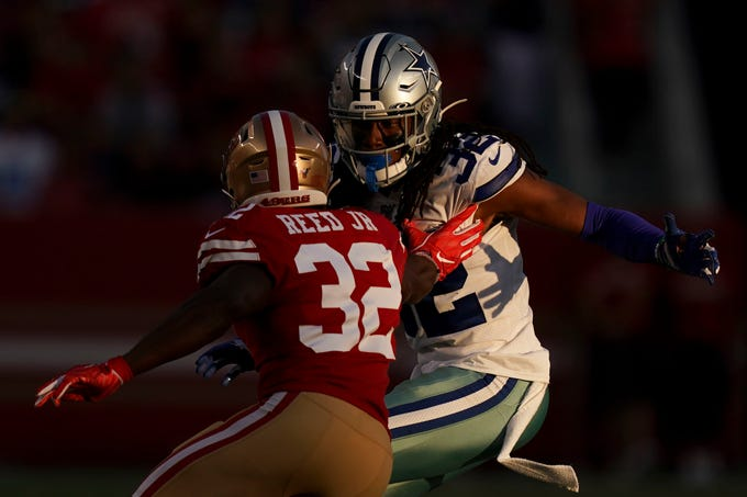 Dallas Cowboys cornerback Donovan Olumba defends against San Francisco 49ers returner D.J. Reed during the second quarter at Levi's Stadium.