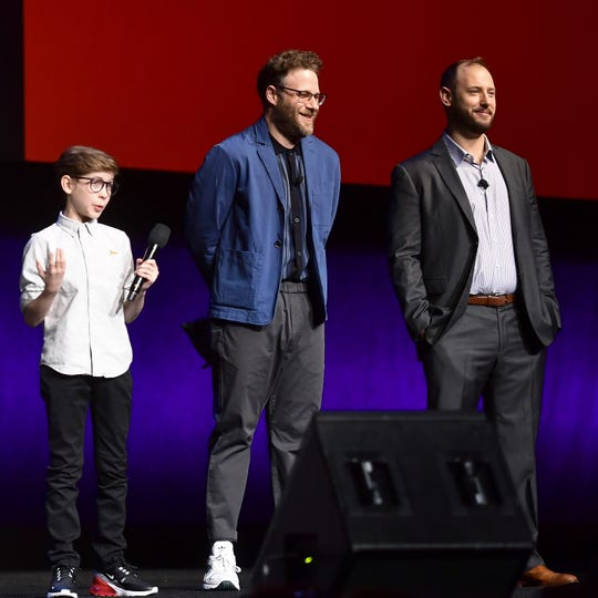 "Jacob Tremblay (left) joins executive producers Seth Rogen and Evan Goldberg onstage at CinemaCon for ""Good Boys."" Rogen and Goldberg also tackled R-rated comedy featuring youngsters with ""Superbad."""