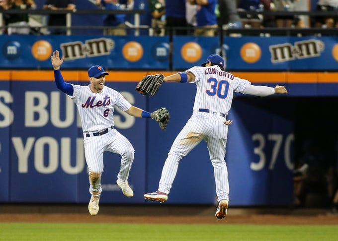 Aug. 10: New York Mets outfielders Jeff McNeil and Michael Conforto celebrate after the team's 4-3 win over the Washington Nationals.