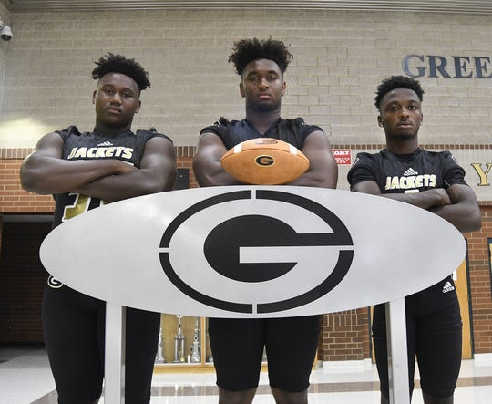 Greer's defensive line will be a handful again with, from left, McZavion Holley (34) and Jakyre Kerns (12), while Cam Martin, right, will have the opportunity to make plenty of plays on both offense and defense.