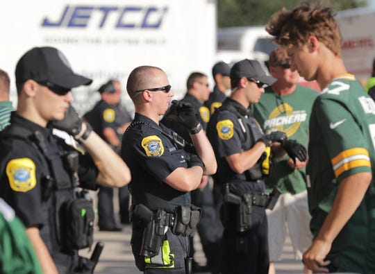 Green Bay police officers provide security Aug. 8 before the Green Bay Packers' preseason football game at Lambeau Field in Green Bay. Area law enforcement officials say they're prepared for this weekend's activities in and around Lambeau Field in Green Bay. The festivities include Eric Church concerts at the Resch Center on Friday and Saturday, country duo Big & Rich performing Saturday night in the Lambeau parking lot, and the Packers home opener against the Minnesota Vikings at noon Sunday.