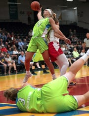 The Wisconsin Glo's Jessica Lindstrom (21) battles against the Music City Icons during a Global Women's Basketball Association championship semifinal on Aug. 10 at Menominee Nation Arena in Oshkosh.