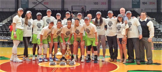Wisconsin Glo players and coaches pose with the trophy after winning the Global Women's Basketball Association championship Sunday in Oshkosh.