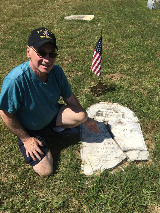 Bob Smith next to Civil War soldier Daniel Carhart's gravestone in Keyport's Green Grove Cemetery.