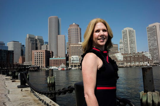 "Deborah Sweeney, CEO of MyCorporations.com, stands for a photograph in Boston with the Boston skyline visible behind. Small business owners looking for new staffers in a tight job market have to get creative to compete with big companies that can offer larger salaries and better benefits. ""You can meet someone once and just say goodbye, or you see a pattern of great behavior,"" Sweeney says. ""I believe it's not the skill set you have per se but the attitude you have."""