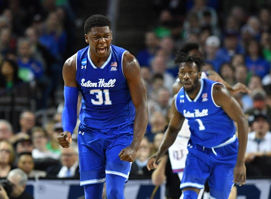 Seton Hall Pirates center Angel Delgado (31) celebrates after a basket against the Kansas Jayhawks in the first half in the second round of the 2018 NCAA Tournament