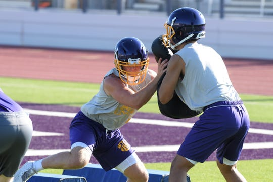 Wylie linebacker Jackson Smith (12) works off a blocking pad during the first fall practice at Bulldog Stadium. Smith will be one of the leaders of the defense this season as he enters his third year of playing time.