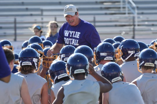 Wylie head coach Hugh Sandifer talks to his football team during the first fall practice on Monday. Sandifer felt Monday was a good start, but there is still work to be done before the season begins at the end of the month.