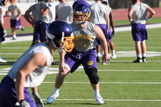 Wylie linebacker Dax Morris (25) reacts to the snap during the first fall practice on Monday. Morris missed half of the 2018 season with an injury, but is back for his senior year.