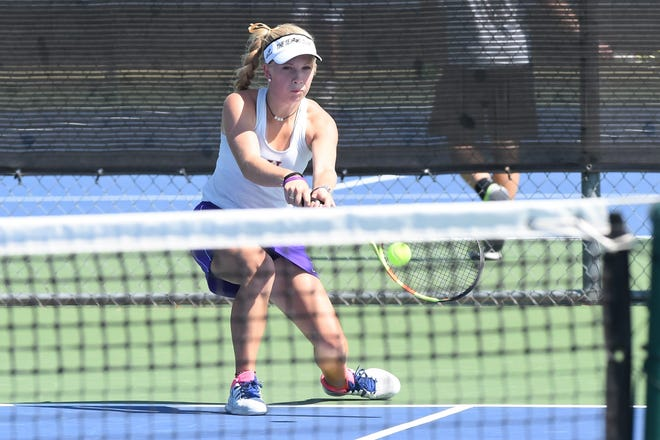 Wylie's Carly Bontke reaches for a shot against Lubbock High on Monday afternoon. Bontke won 6-1, 6-0 at No. 3 girls singles and picked up a win at No. 2 girls doubles with partner Rebecca Yates as the Bulldogs picked up the 14-4 victory.