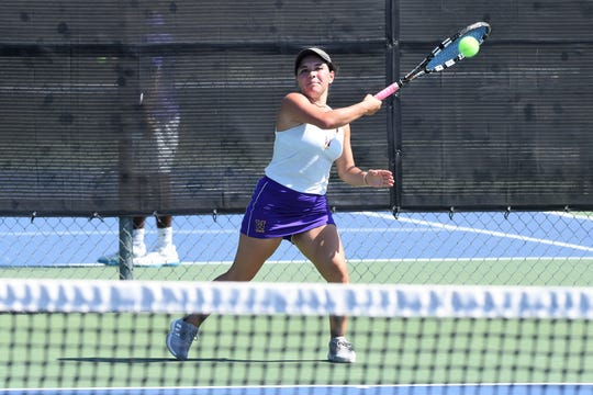 Wylie's Analeah Elias follows through on a shot against Lubbock High on Monday. Elias won 6-1, 6-0 at No. 1 singles and took a 6-1, 6-1 win at No. 1 doubles with Leighton Alford as the Bulldogs improved to 6-0 with a 14-4 win.