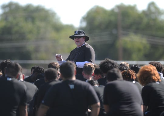 First-year Abilene High football coach Mike Fullen addresses the team Monday, Aug. 12, 2019, following the first fall practice of the season on the on-campus turf practice field.