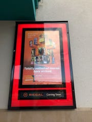 Regal Cinemas in Binghamton offers the Regal Unlimited Plus Movie Pass. An advertisement for Regal's Unlimited Movie Pass is posted on the theater's wall.