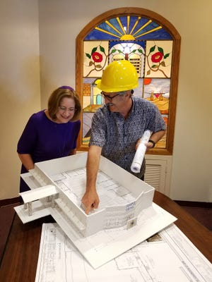 Rabbi Patricia Hickman reviews a model of the new Temple Israel of Brevard with board president and project manager, Larry Fineberg.The temple will host an open house on Sunday, Aug. 25. Photo---