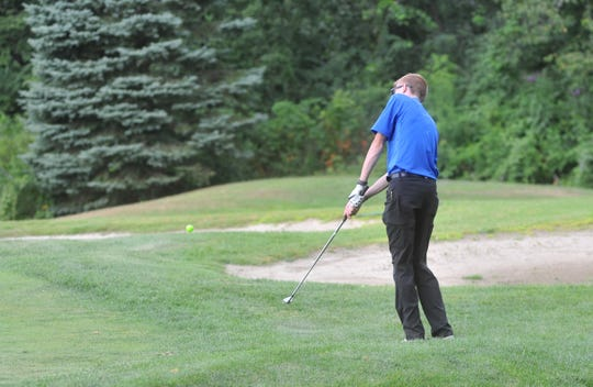 Wynford's Kayleb Keaton chips onto the green on the 12th hole at the Golf Club of Bucyrus.