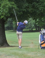 Galion's Spencer Keller hits from the rough on the 17th hole at the Golf Club of Bucyrus.