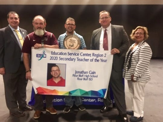 From left, Ryan Johnston, deputy director of operations/CFO for Region 2 of the Education Service Center; James Crenshaw, principal of Flour Bluff High School; Jonathan Gain, Regional Secondary Teacher of the Year; Flour Bluff ISD Superintendent David; and Norma Torres-Martinez, deputy director for instruction for ESC Region 2.