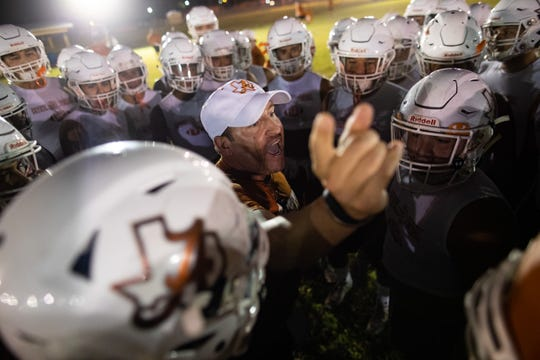The Alice football coach Kyle Atwood talks to his players in a huddle at the start of their first prentice on Monday, Aug. 12, 2019.