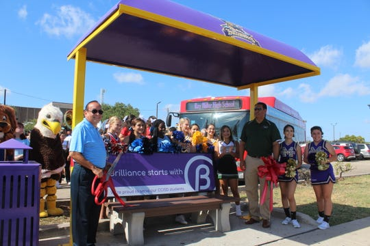The Corpus Christi Independent School District unveils a revamped bus shelter at Roy Miller High School on Monday, Aug. 12, 2019. The Corpus Christi Regional Transportation Authority revamped all CCISD high schools' bus shelters by painting them in the schools' colors and adding their logos to promote school spirit.