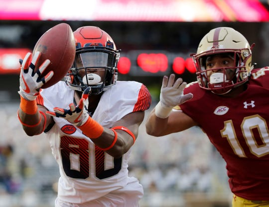 Syracuse wide receiver Taj Harris (80) catches a pass for a touchdown ahead of Boston College defensive back Brandon Sebastian during a game last season.